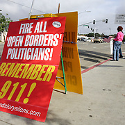 SAN DIEGO, CA, MAY 5, 2007:  Members of the San Diego Minuteman organization, an anti-illegal immigration group, demonstrate at a day labor site in San Diego, California on May 5, 2007. The Minutemen harass those looking for work by questioning their legality. Their presence keeps employers from stopping to pick up the laborers. (Photo by Todd Bigelow/Aurora) Please contact Todd Bigelow directly with your licensing requests.