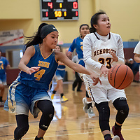 Jayme Daniels (33) of Rehoboth loses the ball on the fast break as Kaitlyn Romencito (4) of Zuni reaches in for the steal during the championship game in Rehoboth on Saturday. Zuni won 48-37.
