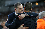 West Ham United manager Slaven Bilic hugs Louis van Gaal, the Manchester United Manager before k/o. The Emirates FA cup, 6th round replay match, West Ham Utd v Manchester Utd at the Boleyn Ground, Upton Park  in London on Wednesday 13th April 2016.<br /> pic by John Patrick Fletcher, Andrew Orchard sports photography.