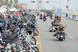 Riding down the Seawall during the Lone Star Rally. Galveston, TX. USA. Friday November 3, 2017. Photography ©2017 Michael Lichter.