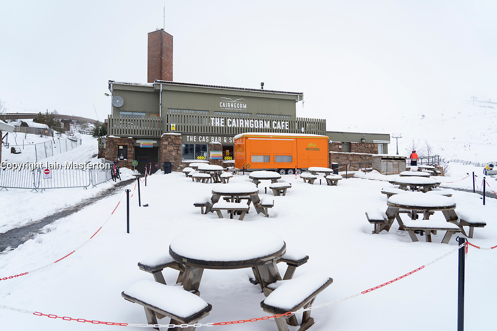 Aviemore, Scotland, UK. 6 May 2021. Heavy overnight snowfalls in the Cairngorms National Park gave an unseasonal wintry look to the landscape. Keen mountaineering skiers made the most of the conditions despite the chairlifts being closed. This meant long walks up the slopes before skiing off-piste downhill. Pic; Cairngorm Cafe not busy in the scow. Iain Masterton/Alamy Live News
