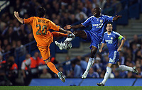 Photo: Paul Thomas.<br /> Chelsea v Barcelona. UEFA Champions League, Group A. 18/10/2006.<br /> <br /> Claude Makelele of Chelsea jumps for the ball with Deco (L).