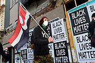 A protestor holds a flag as he walks towards Parliament building on 06 June, 2020 in Melbourne, Australia. This event was organised to rally against aboriginal deaths in custody in Australia as well as in unity with protests across the United States following the killing of an unarmed black man George Floyd at the hands of a police officer in Minneapolis, Minnesota. (Photo by Mikko Robles/ Speed Media)