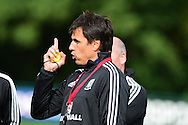 Wales football team manager Chris Coleman looks on during the Wales football team training session at the Vale Resort, Hensol Castle near Cardiff ,South Wales on Monday 31st August  2015. The team are preparing for their next EURO 2016 qualifying match away to Cyprus later this week.<br /> pic by Andrew Orchard, Andrew Orchard sports photography.