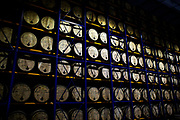 Stacks of bourbon barrels begin the aging process in the warehouse of Mitcher's Distillery.