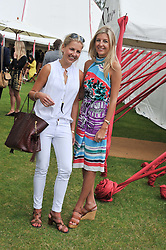 Left to right, sisters HANNELI RUPERT and CAROLINE RUPERT at the Cartier Queen's Cup Polo Final, Guards Polo Club, Windsor Great Park, Berkshire, on 17th June 2012.