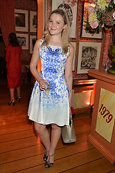 AMBER ATHERTON at a party to celebrate 35 years of Harry's Bar, 26 South Audley Street, London on 19th September 2014.