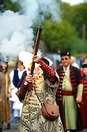 Man firing a musket in tradtional Hungarian costume celebrating the wine festival - Badascony, Hungary .<br /> <br /> Visit our HUNGARY HISTORIC PLACES PHOTO COLLECTIONS for more photos to download or buy as wall art prints https://funkystock.photoshelter.com/gallery-collection/Pictures-Images-of-Hungary-Photos-of-Hungarian-Historic-Landmark-Sites/C0000Te8AnPgxjRg