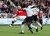 Photo: Paul Thomas. <br />Dunfermline v Manchester United. Pre season Friendly.<br />08/08/2007. <br /><br />Sol Bamba (R) battles with Wayne Rooney of Utd.