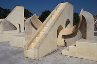 Jantar Mantar is a collection of architectural astronomical instruments. The Jaipur observatory is the largest and best preserved. It has been described as an expression of the astronomical skills and cosmological concepts of the court of a scholarly prince at the end of the Mughal period.  Jantar Mantar literally means: calculation instrument.  The observatory is made up of fourteen geometric devices. These are for measuring time, predicting eclipses and tracking stars,  each is fixed & focused.  Restored in 1901, though it looks modern, the Jantar Mantar was declared a national monument of India in 1948.