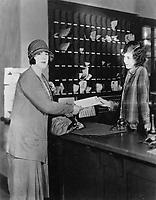 1927 Margaret Chute & Eveleth Atkinson (behind desk) at the Hollywood Studio Club's reception desk