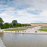 View of Schonbrunn Palace from the Neptune Well in the Summer Palace's gardens, Vienna, Austria.