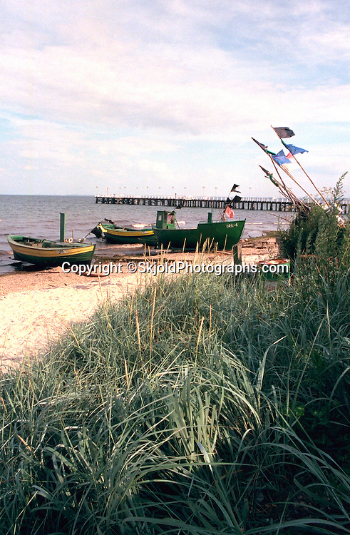 Fishing boats and long pier on a sweet seaside day.  Gdynia Poland