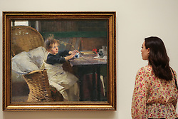 "© Licensed to London News Pictures. 17/07/2019. London, UK. A staff member views Helene Schjerfbeck's painting ""The Convalescent (1888)"" at Royal Academy of Arts during the preview of her first ever exhibition in the UK. The exhibition features around 65 portraits, landscapes and still life, charting the development of Helene Schjerfbeck's work from a naturalistic style inspired by French Salon painters in the early 1880s, to a radically abstracted and modern approach from the turn of the twentieth century onwards. The exhibition runs  from 20 July to 27 October 2019. Photo credit: Dinendra Haria/LNP"