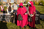 17 OCTOBER 2020 - DES MOINES, IOWA: Women wearing a costume from the Handmaid's Tale waits for the We Dissent Women's March to start. About 300 women participated in the We Dissent Women's March in Des Moines. The march was one of several held across the US to protest the confirmation of Amy Coney Barrett to the Supreme Court seat once held by Ruth Bader Ginsburg. The women marched through downtown and passed by the closed offices of US Senators Chuck Grassley and Joni Ernst.         PHOTO BY JACK KURTZ