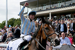 Jockey Tom Queally celebrates on Higher Power after winning the Stobart Rail Northumberland Plate Handicap during the Betfred Northumberland Plate Day at Newcastle Racecourse.