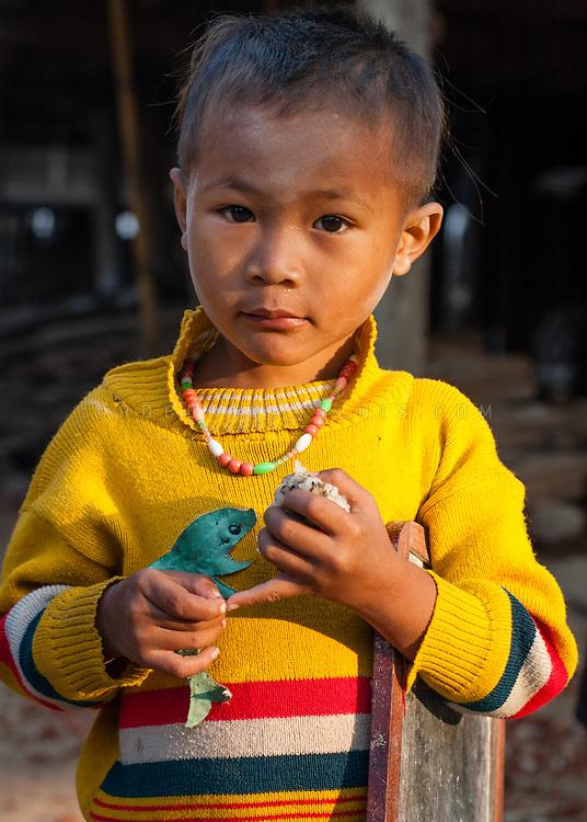 Portrait of a boy in Kham Province, Laos. Photo © robertvansluis.com