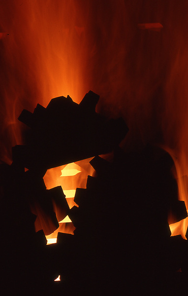 Stock photo of machine parts sitting in the fire