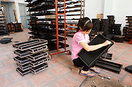 A young woman works in a workshop in Hanoi, Vietnam, Southeast Asia