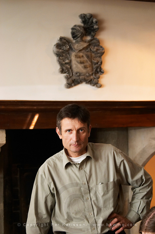 Alberic Mazoyer, then winemaker and director at Chapotier in Hermitage, now part-owner and wine maker at Alain Voge in Cornas.Under a coat of arms for Chapoutier.  Domaine M Chapoutier, Tain l'Hermitage, Drome Drôme, France Europe