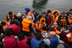 February 26, 2016 - Chios, Greece - A boat with immigrants is arriving in the shores of Chios island, Greece. Five boats with about 220 refugees arrive on the shore near to Karfas beach, south of the port city of Chios, after crossing the Aegean sea from Turkey  (Credit Image: © Dimitrios Chantzaras/NurPhoto via ZUMA Press)