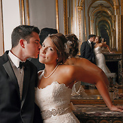A married couple poses for a portrait in front of a mirror in The Vista in Columbia. Photo by Columbia SC Wedding Photographer Travis Bell. ©Travis Bell Photography