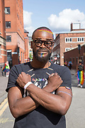 A young black male with rainbow coloured face paint from Rainbow Noir during the Manchester Pride Parade on the 25th August 2018 in Manchester in the United Kingdom. The Manchester Pride is an annual LGBT pride festival and parade held each summer in the city of Manchester, England. Rainbow Noir is a community group and safe space for LGBTQI people of colour.