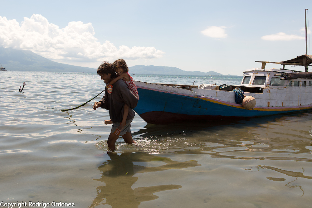 Siti Rofi'ah's son-in-law Jainudin One, 41, who just returned home after fishing overnight, carries his daughter Refa, 6, on his shoulders from his boat to the shore. They live in Lewoleba, Nubatukan subdistrict, Lembata district, East Nusa Tenggara province, Indonesia.