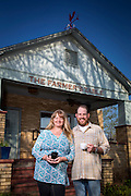 The Farmer's Table owners Adrienne and Rob Shaunfield stand in front of the restaurant on Friday, April 18, 2014,  in Fayetteville, Arkansas. A farm to table, local and organic, restaurant in Northwest Arkansas.<br /> Photo by Beth Hall