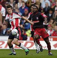 Photo: Jonathan Butler.<br />Southampton v Stoke City. Coca Cola Championship. 21/10/2006.<br />Grzegorz Rasiak of Southampton fends off Salif Diao of Stoke.