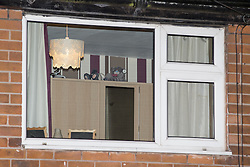 © Licensed to London News Pictures . 08/12/2013 . 78 Springwood Hall Road , Oldham , UK . View through the upstairs window of the house . The 22 year old mother of a four-month old girl , Victoria Adams , was found stabbed in the chest at 78 Springwood Hall Road , Oldham , yesteday morning (8th December 2013) . She later died in hospital . A 29 year old man has been arrested on suspicion of murder .  . Photo credit : Joel Goodman/LNP