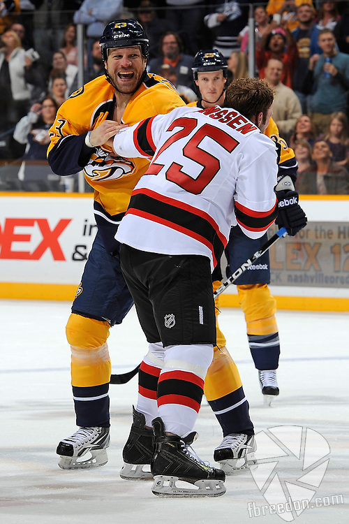 NASHVILLE, TN - OCTOBER 15:  Forward Brian McGrattan #23 of the Nashville Predators fights against Cam Janssen #23 of the New Jersey Devils at the Bridgestone Arena on October 15, 2011 in Nashville, Tennessee.  (Photo by Frederick Breedon/Getty Images)