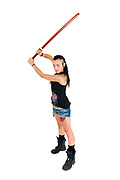 Young punk teen girl wielding a bokken (a wooden Japanese sword used for practice)
