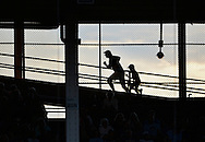 A man and a boy race up the ramps to the upper deck as the Chicago Cubs play the Milwaukee Brewers at Wrigley Field on August 28, 2012 in Chicago, Illinois. The Brewers defeated the Cubs 4-1.