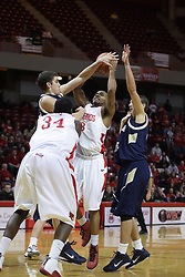 04 December 2010: Trey Blue gets off a shot in the traffic lane guarded by Jeff Budinich and Danny Piepoli during an NCAA basketball game between the Montana State Bobcats and the Illinois State Redbirds at Redbird Arena in Normal Illinois.