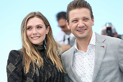Actors Elizabeth Olsen and Jeremy Renner attend the 'Wind River' photocall during the 70th annual Cannes Film Festival at Palais des Festivals on May 20, 2017 in Cannes, France. Photo by ShootPix/ABACAPRESS.COM