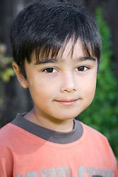 Portrait of a little boy in the garden,