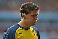 Wojciech Szcesny of Arsenal leaves the field after warming up before the match. Barclays Premier league match, Aston Villa v Arsenal at Villa Park in Birmingham on Saturday 20th Sept 2014<br /> pic by Mark Hawkins, Andrew Orchard sports photography.
