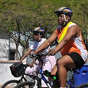Cycling couple heading toward South Tucson.