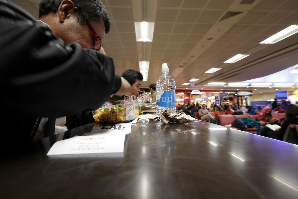 food eating counter at airport layover travelers terminal Heathrow England