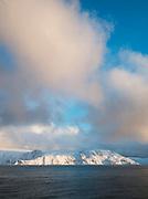 Snowy, frozen landscapes seen from a boat in Finnmark region, northern Norway