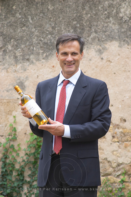 Xavier Perromat, winemaker with a bottle of Chateau de Cerons wine Chateau de Cerons (Cérons) Sauternes Gironde Aquitaine France