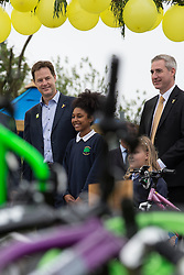 © Licensed to London News Pictures . 03/07/2014 . Leeds , UK . The Deputy Prime Minister , NICK CLEGG MP , at Ireland Wood Primary School in Leeds today (Thursday 3rd July 2014) shown around by pupil Lashay Henry-Welsh (11) from Yeadon in Leeds (centre) with local MP Greg Mulholland (Liberal Democrat Leeds North West constituency . The Liberal Democrat leader and MP for Sheffield Hallam watches a Grand Depart school event with children taking part in cycling time trials and singing the the Tour de France anthem . Photo credit : Joel Goodman/LNP