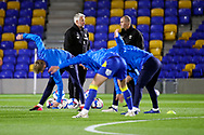 AFC Wimbledon assistant manager Nick Daws and AFC Wimbledon coach Mark Robinson taking warm up during the EFL Sky Bet League 1 match between AFC Wimbledon and Peterborough United at Plough Lane, London, United Kingdom on 2 December 2020.