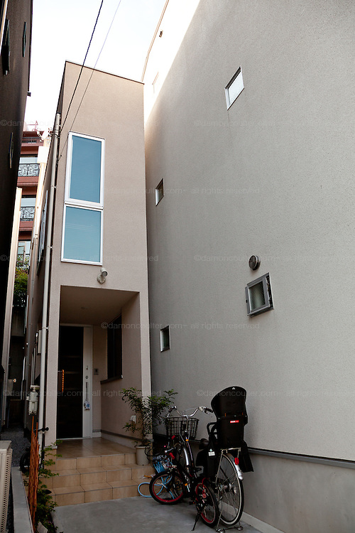 An Incredibly thin house in a small street in Azabu, Tokyo, Japan. Friday May 30th 2014