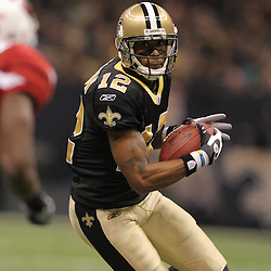 16 January 2010: New Orleans Saints wide receiver Marques Colston (12) runs after a catch against the Arizona Cardinals during the first half of the 2010 NFC Divisional Playoff game at the Louisiana Superdome in New Orleans, Louisiana.
