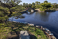 Yosuien Garden was built by the 10th lord of the Kishu Tokugawa domain as an addition to the Nishihama Goten palace. It is typical of the Tokugawa era. Yosuien is a strolling pond style garden with trails that encircle the pond, leading visitors over various types of unique bridges to islands within the pond.  Adjacent to the pond garden is the Yosuitei teahouse built in the Sukiya style tea ceremony style and the Omotesenke tearoom.  Its official name is Minato Goten Palace.  The garden is most famous for its unique arched bridges.