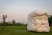Janus' Fortress: Folkestone by Pilar Quinteros is a monumental sculptural head with two faces, representing Janus, the Roman god of beginnings and transitions,who was often associated with thresholds – and so also with a present poised between the past and the future on 20th of July 2021, in Folkestone, United Kingdom. The sculpture is located high up on the East Cliff, overlooking Folkestone's harbour, and with its two faces is able to look both towards the European mainland and towards England, connecting them, as Folkestone hasalways done whether as a fortress or a port. It is made of chalkand plaster, and will gradually erode and disintegrate. The artist's intention was to make a kind of anti-monument, imposing in scale but ephemeral and vulnerable. Its disintegration also mirrors (and reflects on) the gradual erosion of the chalk cliffs and coastline. The white cliffs of Dover are sometimes referred to as the fortress walls of England. The artwork is part of the Creative Folkestone Triennial 2020, The Plot, which sees 27 newly commissioned artworks appearing around the south coast seaside town. The new work builds on the work from previous triennials making Folkestone the biggest urban outdoor contemporary art exhibition in the UK.