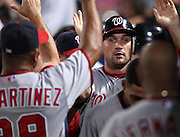 ATLANTA, GA - AUGUST 30:  Third baseman Ryan Zimmerman #11 of the Washington Nationals (upper right) is congratulated by teammates in the dugout after scoring a run during the game against the Atlanta Braves at Turner Field on August 30, 2011 in Atlanta, Georgia.  (Photo by Mike Zarrilli/Getty Images)