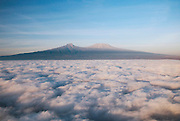 View of Mount Kilimanjaro from an airplane flying above the clouds, Chyulu Hills, Kenya